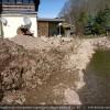 Vorbereitung der Berme zum Einbau der Buschlagen auf den Fußsteinen des Steinsatzes